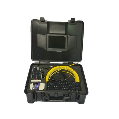 Image of pipe inspection camera system by VICAM MECHATRONICS model V715DK featuring rod & reel with fixed camera head, control station, full Qwerty keyboard, monitor, battery, all together in rugged carrying case.